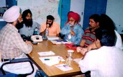Office bearers of Guru Nanak Sarbat Sikh Sangat discuss relief efforts.